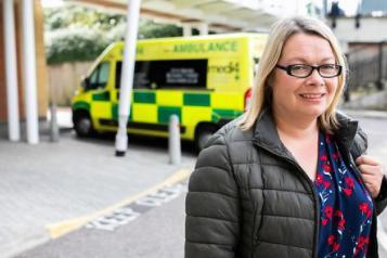 Lady infront of ambulance