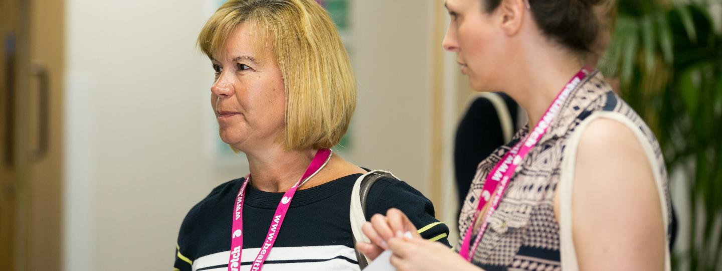 Healthwatch staff at an event talking to the public